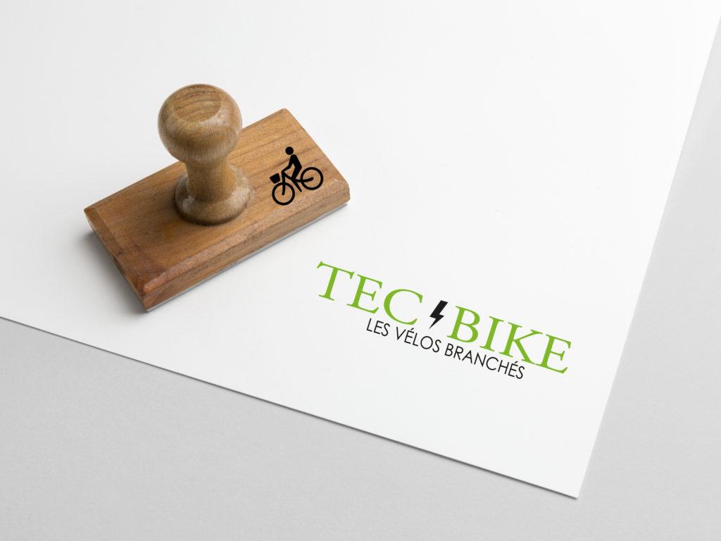 TEC BIKE est un service de vélo à assistance électrique, qui propose leur services pour les petites villes de province. TEC pour la technologie, BIKE pour le vélo, la couleur verte pour le côté écologique et l'éclair pour l'électricité.